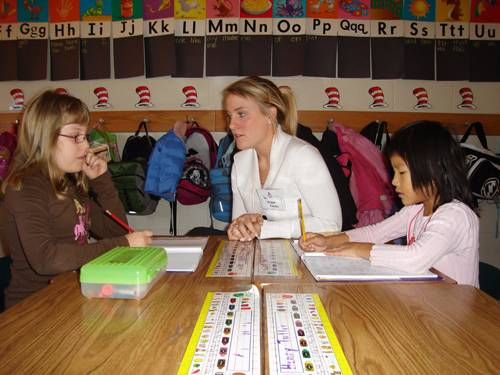 A student-teacher works with children.
