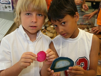 Two elementary boys holding rock samples